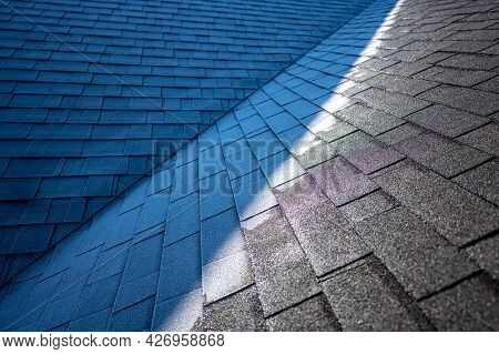 Contrast Of Frost Line On A Shingle Roof As The Sun Rises And Melts It