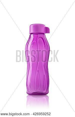 Tupperware Plastic Bottle. Plastic Pink Drinking Bottle With Ergonomic Cap Isolated On White Backgro