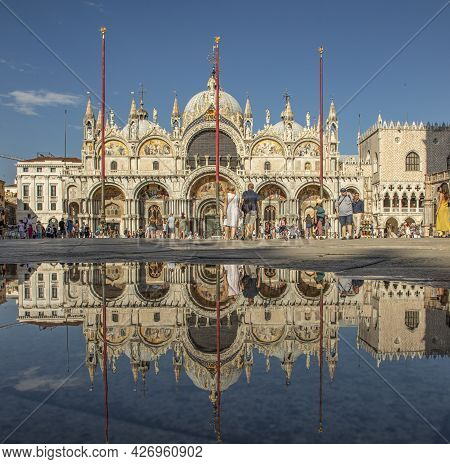Venice, Italy - July 2, 2021: Reflection Of Cathedral San Marco At San Marco Square In Venice, Italy