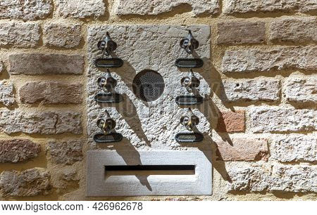 Venice, Italy - July 1, 2021: Brass Bell Button Made Like Funny Faces At An Old Apartment House In T