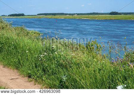 Forest Natural Pond. River Or Fishing Pond. Landscape A Beautiful Pond.