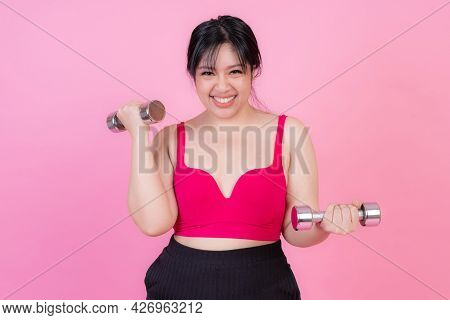 asian fat women , Fat girl , Chubby, overweight plus size attempt exercises with dumbbell lifting in