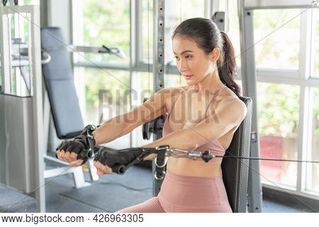 Beautiful Fitness Woman Working Push Up With Dumbbells In A Gym Fitness Room , Asian Sexy Girl Slim