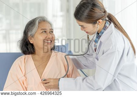 the nurses are well good taken care of elderly patients in hospital bed patients  feel happiness - m