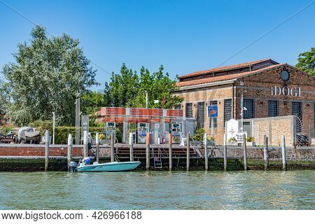 Murano, Italy - July 1, 2021: Petrol Station At The Canal In Burano, The Island Of Venice With Histo