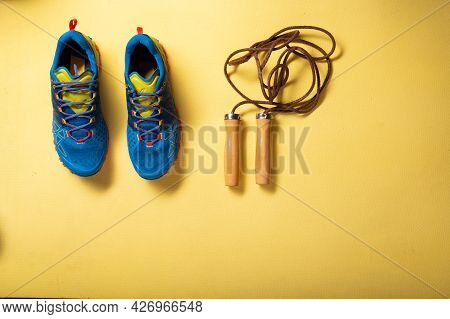 Sports Sneakers And Skipping Rope. Cardio On A Rope. Rope Exercises. Top View.