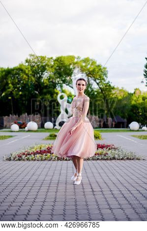 A Ballerina In A Long Pink Silk Dress Spins In A Dance In The Park In Summer, Ballet In The Urban La