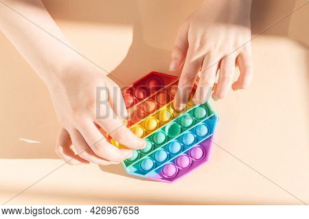Hands Are Using Rainbow Push Pop It Bubble Sensory Fidget Toy, Sensory Silicone Toys For Autism, Fid