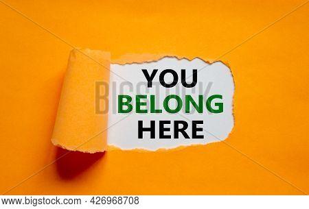 You Belong Here Symbol. Words 'you Belong Here ' Appearing Behind Torn Orange Paper. Beautiful Orang