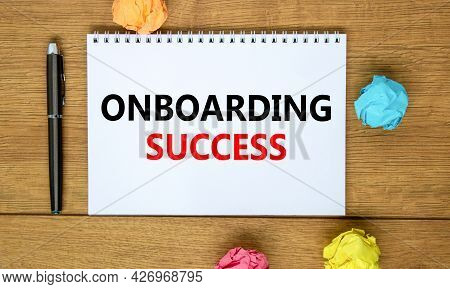 Onboarding Success Symbol. Words 'onboarding Success' On White Note On Beautiful Wooden Table, Color