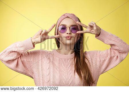 Mwah Followers. Cheeky And Sassy Cute Glamour Young European Girl Wearing Sunglasses, Sweater Showin