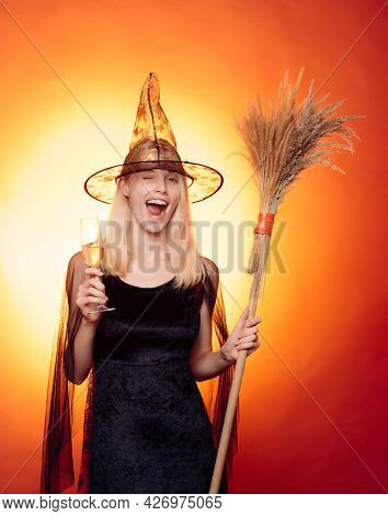 Sexy Blonde Witch. Girl Play With Pumpkins And Treat. Happy Halloween Weekends. Witch Hat. Halloween