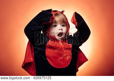 Halloween Party And Funny Child. Horror Faces. Holiday Halloween With Funny Carnival Costumes On A H