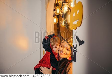 Happy Family. Halloween Party And Funny Pumpkin. Holiday Halloween With Funny Carnival Costumes On A