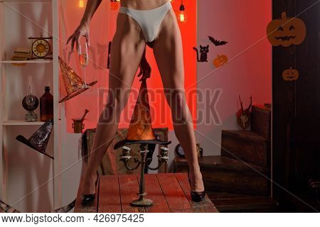 Sexy Halloween Party And Funny Pumpkin. Sexy Models Posing In Lingerie On Halloween Background. Fema