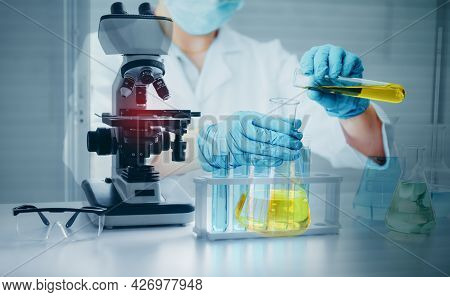 Science Oil Chemistry Expertise Is Experiment Analysis With Microscope Equipment In Laboratory. Doub