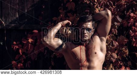 Bloody Man Posing With Pumpkin. Halloween Party And Funny Pumpkin. 31 October. Best Ideas For Hallow