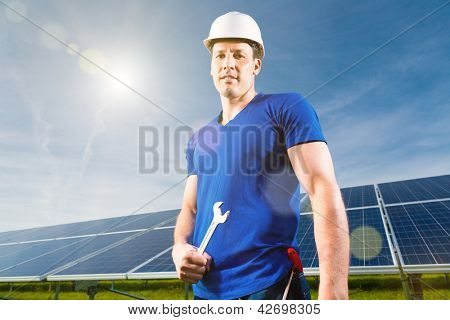 Photovoltaic system with solar panels for the production of renewable energy through solar energy, a technician or worker standing in front