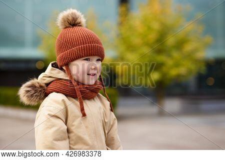 Portrait Of Cute Little Girl Walking In Autumn Park