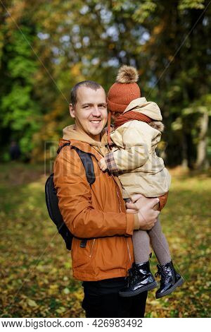 Family, Parenthood, Love And Care Concept - Father And Cute Little Daughter In Autumn Park Or Forest