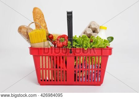 Shopping Basket Full Of Healthy Food Isolated Over White Background