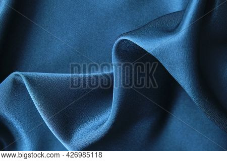 Blue Silk Drapery And Upholstery Fabric From The Courtyard. Blue Satin, Silky Fabric, Wave, Draperie