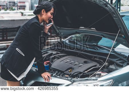 Young Businesswoman Whose Car Breakdown Uses Mobile Phone To Call For Roadside Assistance Service. T