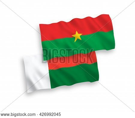 National Fabric Wave Flags Of Burkina Faso And Madagascar Isolated On White Background. 1 To 2 Propo