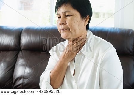 Senior Adult Women Touching The Neck Feeling Unwell Coughing With Sore Throat Pain.healthcare And Me