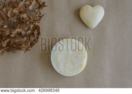 One Piece Of Round Natural Handmade Soap, Dry Flower Of Buldenezh And Souvenir Heart On Craft Paper.