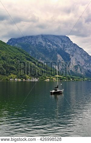 Beautiful Misty And Cloudy Landscape With Lake And Mountains In Summer. Natural Colorful Background.
