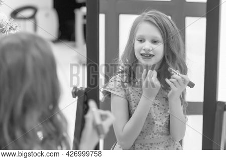 Charming Girl Painting Lips With Lipstick While Standing In Front Of Mirror, Adorable Stylish Girl P