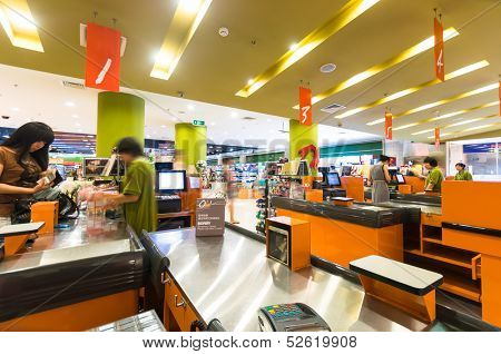 BEIJING,CHINA - JULY 6: Hualian supermarket cashiers on July 6th 2010 in Beijing. Hualian is China's first supermarket chains listed companies.