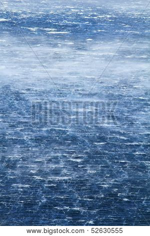 Raging sea with furious waves and fierce wind poster