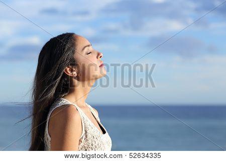 Profile Of A Beautiful Arab Woman Breathing Fresh Air In The Beach