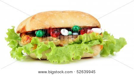 Conceptual image for nutritional care:assorted vitamins and nutritional supplements in bun.Isolated on white