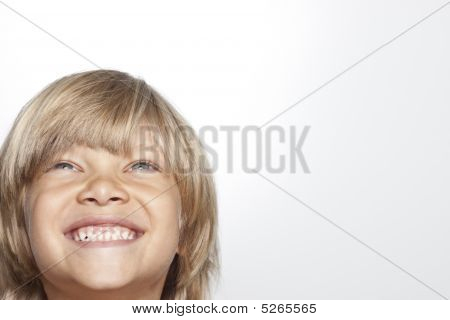 Young Child Looking Up Laughing