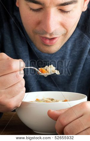 Man Eating Chicken Soup