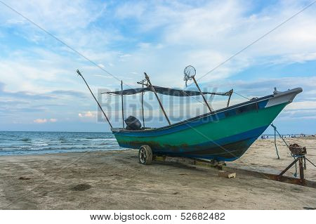 Traditional Fisherman Wooden Boat with blue skies poster