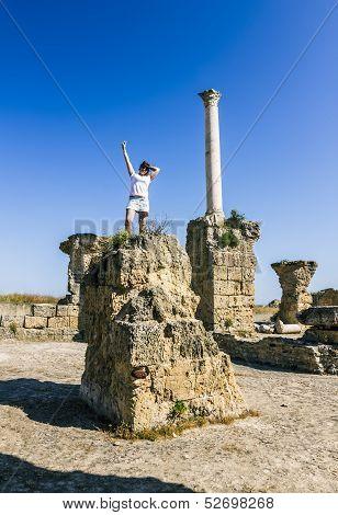 Girl Posing Amid The Ruins Of Carthage