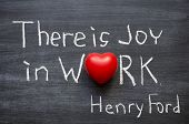 "excerpt from famous Henry Ford quote ""There is joy in work. There is no happiness except in the realization that we have accomplished something."" handwritten on blackboard poster"