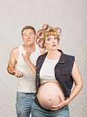 Frustrated man with annoyed pregnant hillbilly woman poster