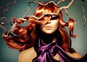 Red Hair. Fashion Model Woman Portrait with Long Curly Red Hair. Hair Extension  poster