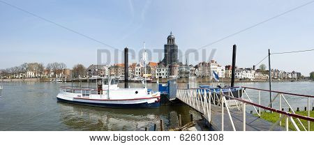 Panoramic View Of City With Ferryboat