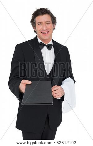 Portrait of confident waiter giving bill pad isolated over white background