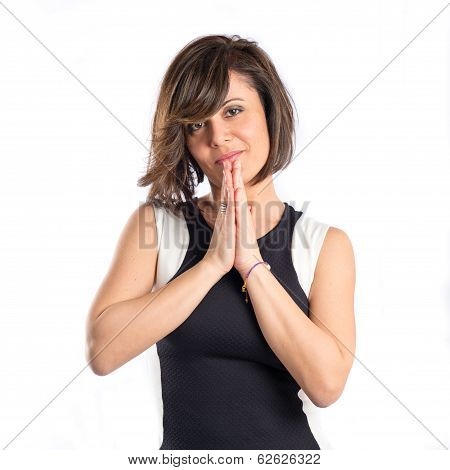 Woman In Black Clothes Pleading Over White Background