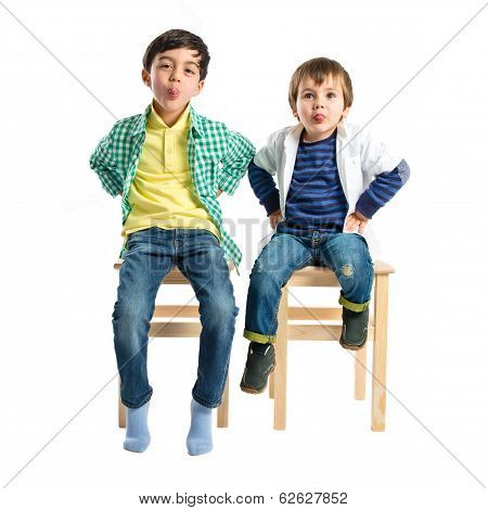 Boys Making A Mockery Over Isolated Background