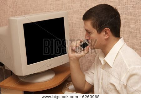 thinking man near black screen