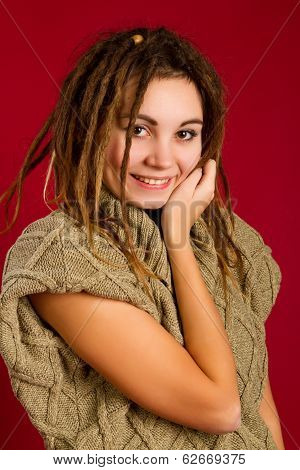 Woman With Dreadlocks On A Red Background