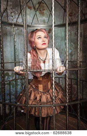Frightened Beautiful Steampunk Woman In The Cage